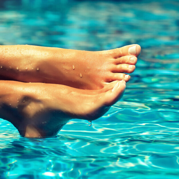 Perfect,Clean,Female,Feet,Above,Water,.,Beautiful,And,Elegant